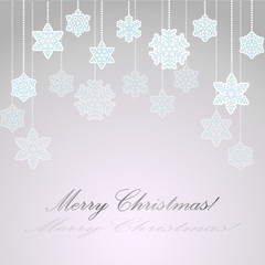 Light blue background with paper snowflakes on a string of beads for greeting cards for new year or Christmas