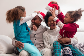 Black family together on christmas day having fun