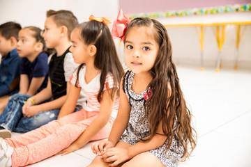 Cute little preschool girl in a classroom