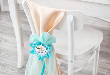 Chair decorated with award ribbon, indoors