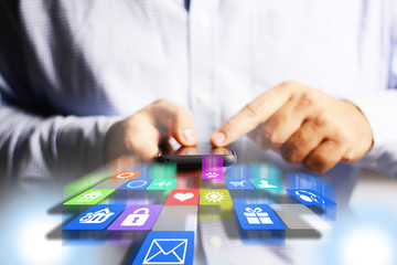 Smartphone with application a Icons in businessman hands, apps development concept