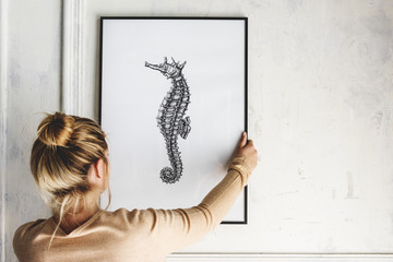 Photo of hand drawing seahorse is hanging on the wall