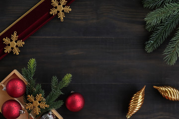 Top view of  christmas ornaments with red ,silver decoration ball, snowflake ััyarn ,pine brance on black wood table top,Flat lay , holiday celebration still life,mock up for adding text,copy space