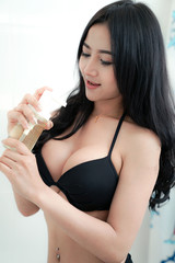 Adult asian young sexy lady with big breast and black long hair in black bikini be full of sex appeal