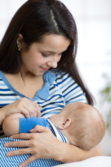 Baby feeds on mother's breasts milk