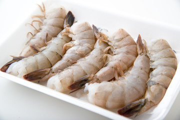 isolated black tiger shrimp in plastic tray