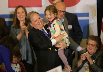 Democratic Alabama U.S. Senate candidate Doug Jones holds his granddaughter as he celebrates with supporters at the election night party in Birmingham