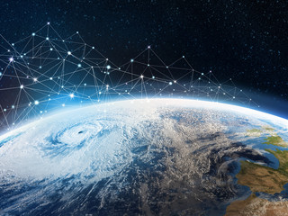 Global communication network across the planet Earth. Storage of data in the cloud storage. A look from space to the hurricane and part of the continent. Elements of this image furnished by NASA