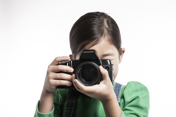 girl(kid) hand hold a camera isolated on the white background.