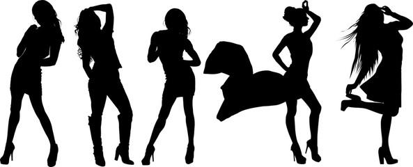 モデルのポーズをとる女性のシルエット