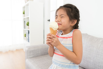 attractive little girl children eating ice cream