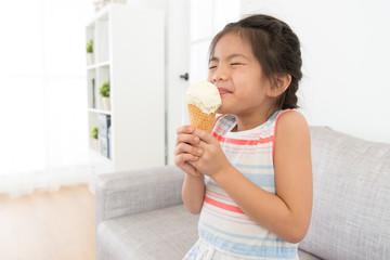 attractive little girl children eating ice cream
