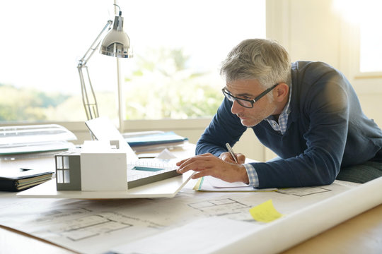 Architect in office working on 3D model