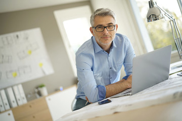 Portrait of architect looking at camera in office
