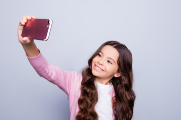 Fashion, education, healthcare, pre teens concept. Close up portrait of charming school girl in fashionable outfit, intelligent and smiley, showing thumb fingers up symbol, wishes good luck