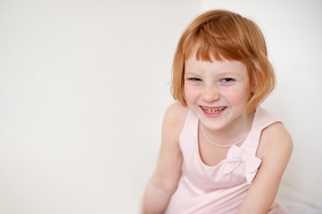 Portrait of a redhead smiling girl with dental caries with copyspace