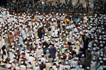 Muslims hold a prayer session on the road as police block them from marching towards the U.S. Embassy to protest against U.S. President Donald Trump's recognition of Jerusalem as Israel's capital in Dhaka