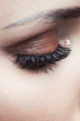 closeup of woman eye with brown eyeshadow