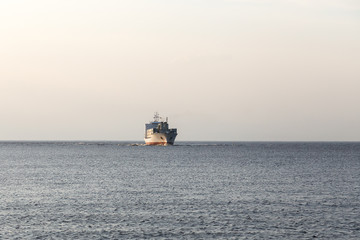 Not the big vessel with containers in the sunset sun.