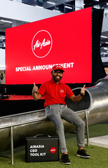 Newly appointed AirAsia CEO of Malaysian Operations Asmat poses for photos after a news conference at AirAsia headquarters in Sepang