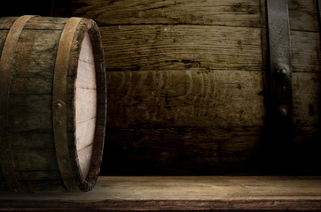 background barrel and worn old table of wood