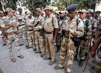 CISF personnel, deployed on election duty, attend a briefing at a distribution centre ahead of the final phase of voting in Gujarat state assembly election in Ahmedabad
