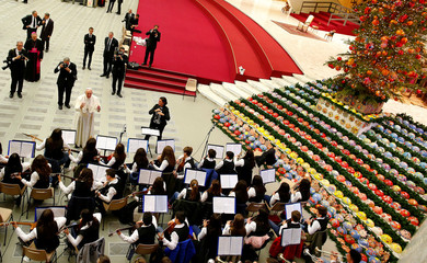 Pope Francis greets members of an orchestra during his Wednesday general audience in Paul VI Audience Hall at the Vatican
