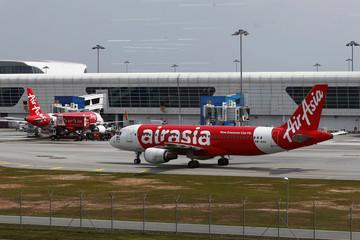 AirAsia planes are seen on the tarmac at Kuala Lumpur International Airport 2 (KLIA2) in Sepang