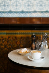 Italian sweets and coffee in a cafe with tiled walls