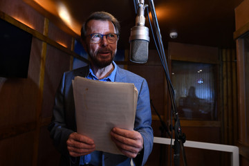 Bjorn Ulvaeus of ABBA sings in an exhibit of a replica of the Polar Studios as part of the opening of 'ABBA: Super Troopers' exhibition at the Southbank Centre in London