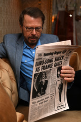 Bjorn Ulvaeus of ABBA reads a newspaper from the time in a replica of the Napoleon Suite at the Brighton Grand Hotel where ABBA celebrated winning the 1974 Eurovision song contest as part of the  opening of 'ABBA: Super Troopers' exhibition at the Southban