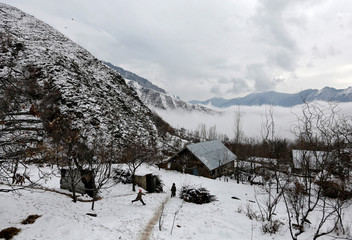Boys play after a snowfall on the outskirts in Srinagar