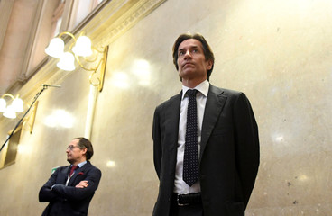 Former Austrian Finance Minister Grasser waits in the courtroom on the second day of his trial for embezzlement in Vienna