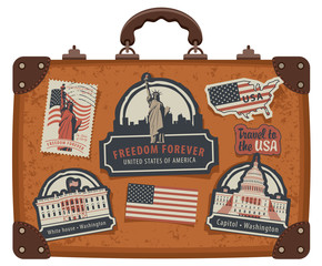 Vector image of travel suitcase with stickers set with American symbols, flag and monuments of the United States of America in retro style