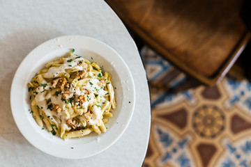 A bowl of fresh homemade pasta on a table in a cafe elevated view