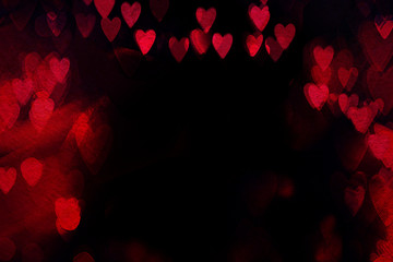 Valentine`s day abstract background with red hearts on a black background