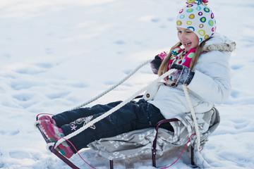littke girl on the sledge