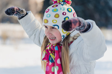 little girl in warm clothing outdoor in winter park