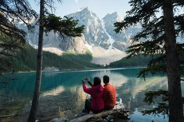 Couple taking picture with mobile phone