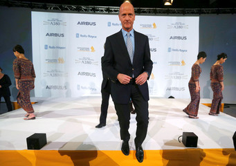 Airbus Chief Executive Tom Enders leaves the stage as he attends a ceremony during the delivery of the new Airbus A380 aircraft to Singapore Airlines at the French headquarters of aircraft company Airbus in Colomiers