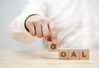 Hand and word Goal made with wooden building blocks