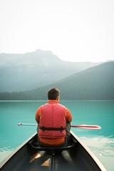 Man sitting in a kayak boat