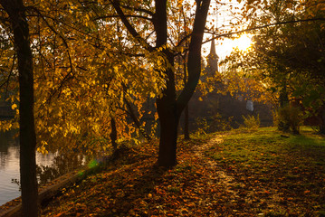 Late autumn scene in sunset light.Church chapel in the background