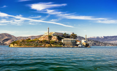 Alcatraz Island and former federal penitentiary on sunny day in San Francisco Bay, California