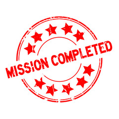 Grunge red mission completed with star icon round rubber seal stamp on white background