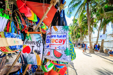 Local souvenir shops - lined white beach in Boracay Island, Philippines