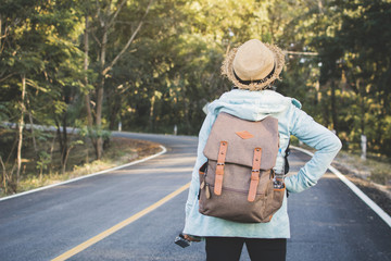 Happy hipster old women backpack traveling on the road relax time and holiday, color vintage style selective and soft focus