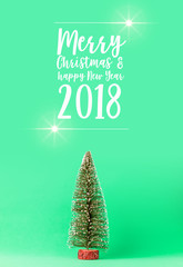 toy pine christmas tree on color background with free copy space for your creativity ideas text festive background