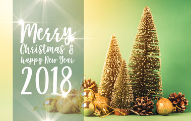 festive background concept with pine christmas tree and new year decorating items on color background with free copy space for your wish text