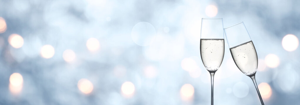 Abstract blue winter background with champagne and bokeh